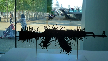 Fetish VI, by South Africa's Michael MacGarry, shows an AK-47 rifle covered in nails, reminiscent of the Congolese Nkondi figurings used to ward of evil spirits.